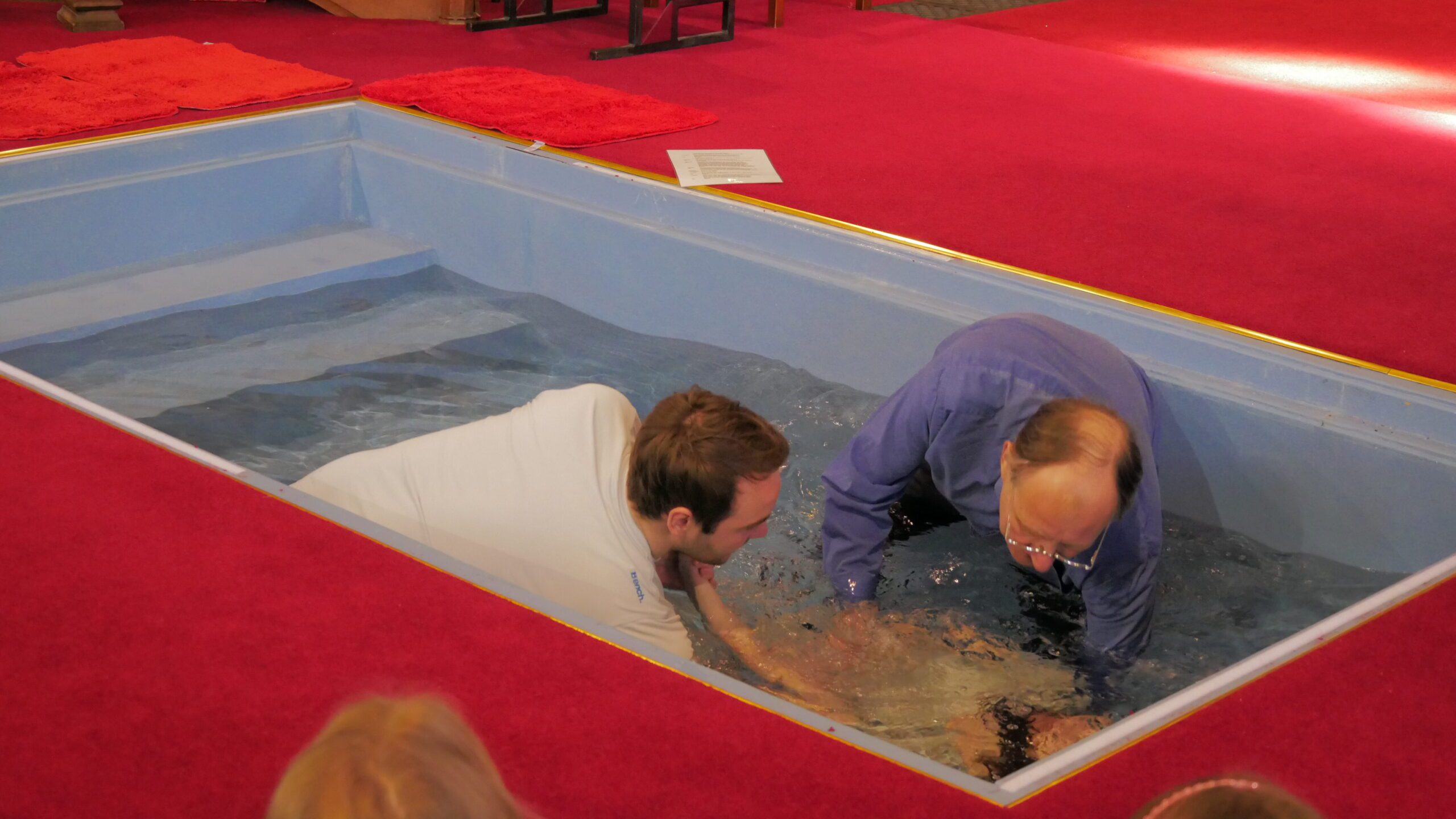 Picture of a baptism by immersion in All Saints Church, Chester.